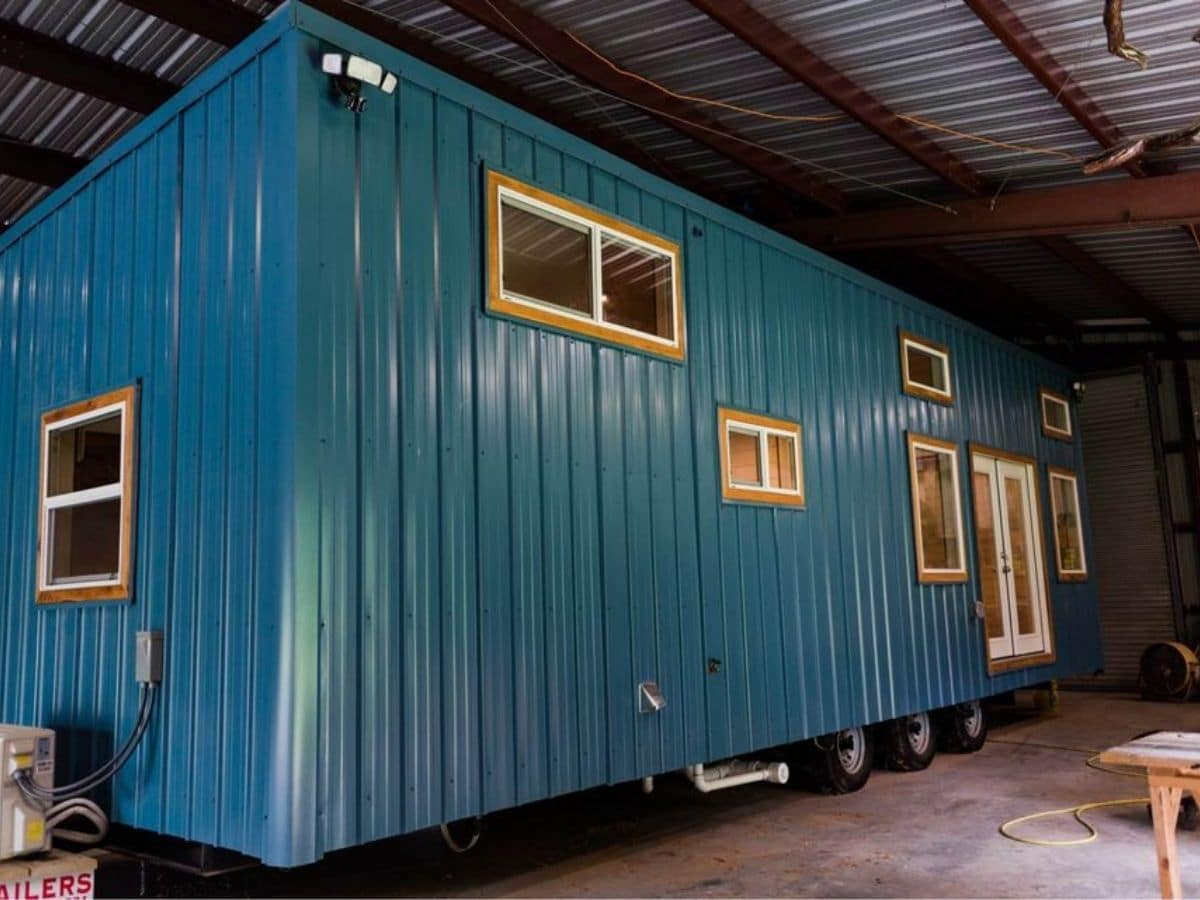 Teal metal siding on tiny house in shop
