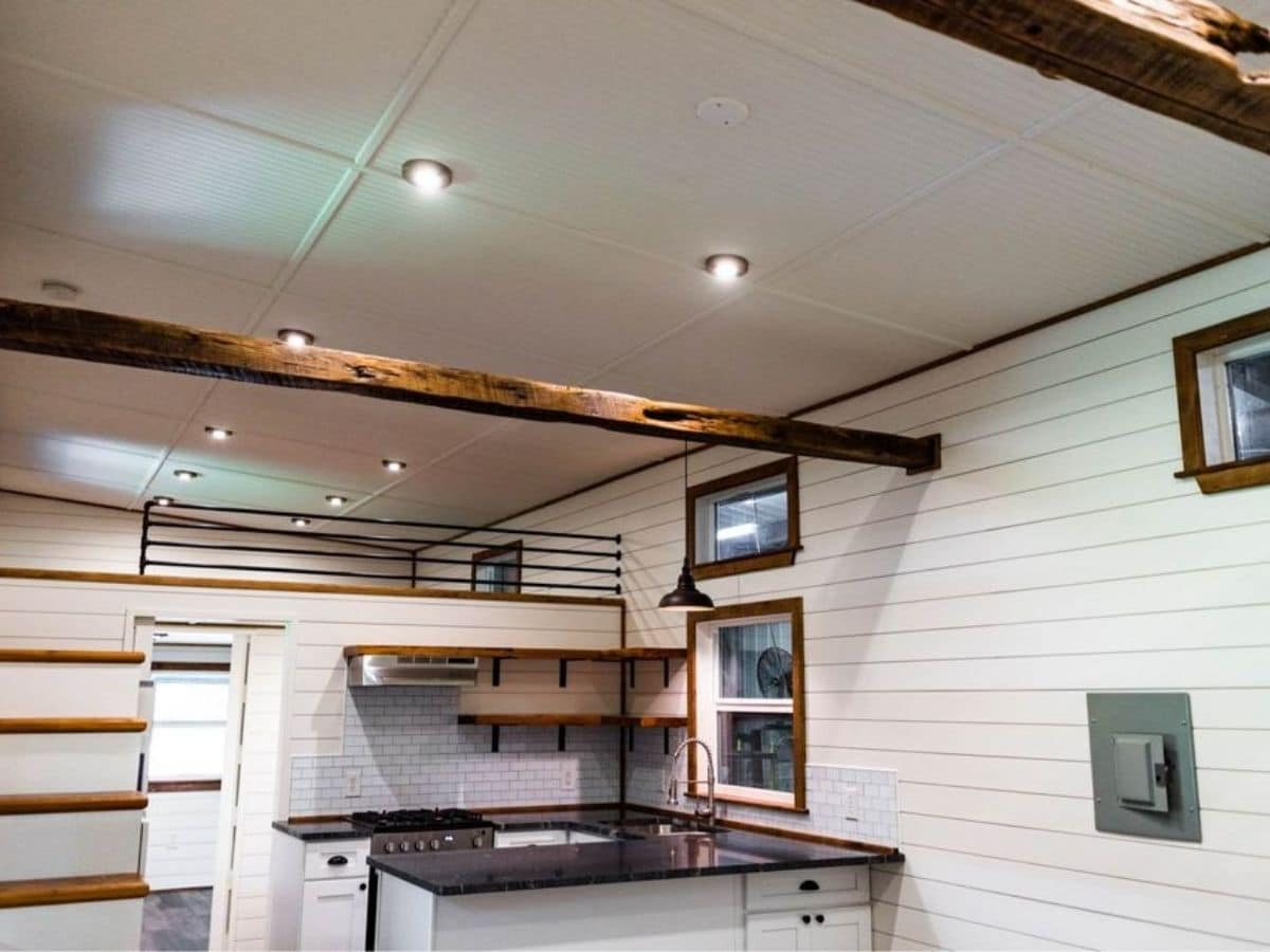 View into tiny home kitchen with black counters