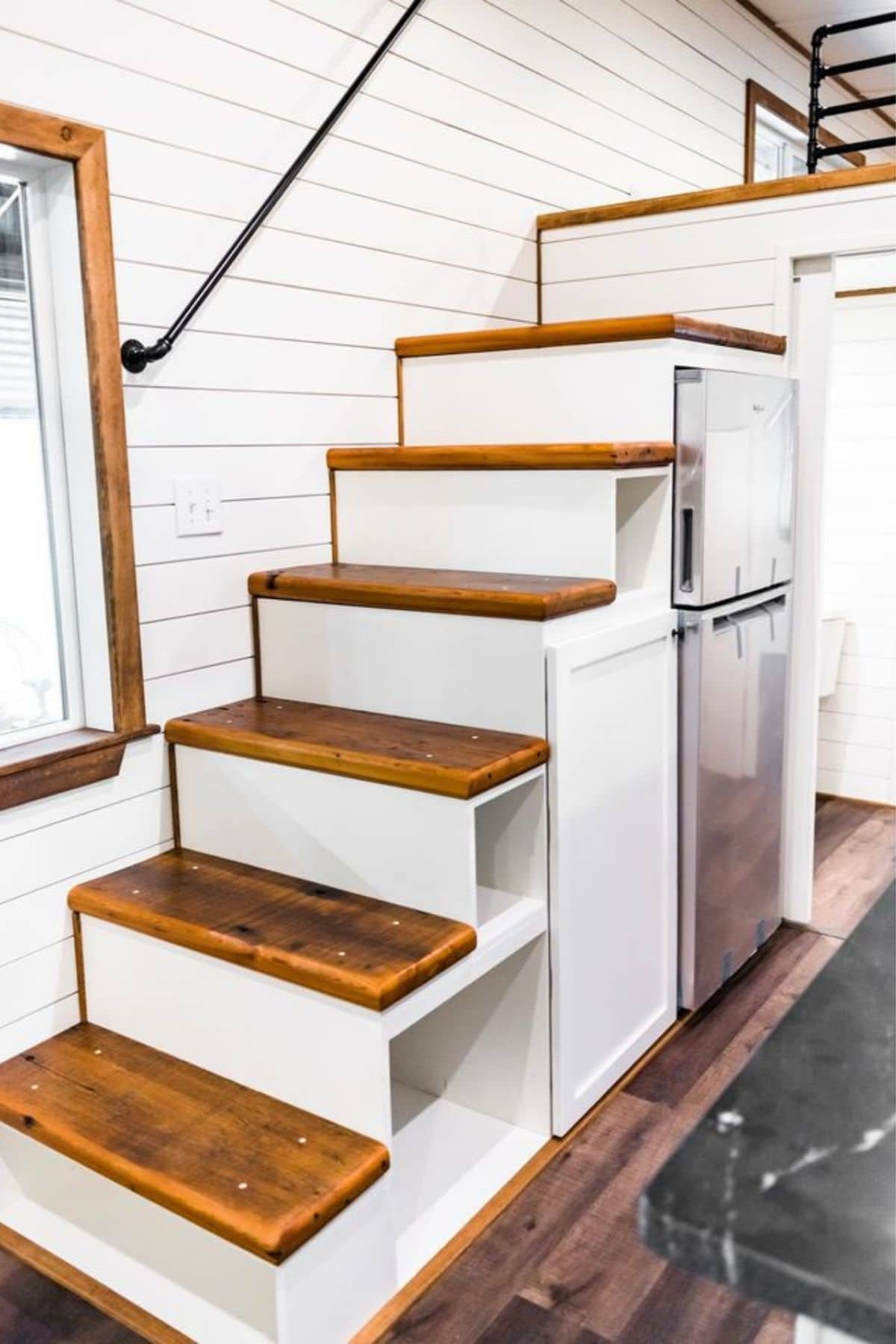 White stairs with cubbies beneath and wood tops