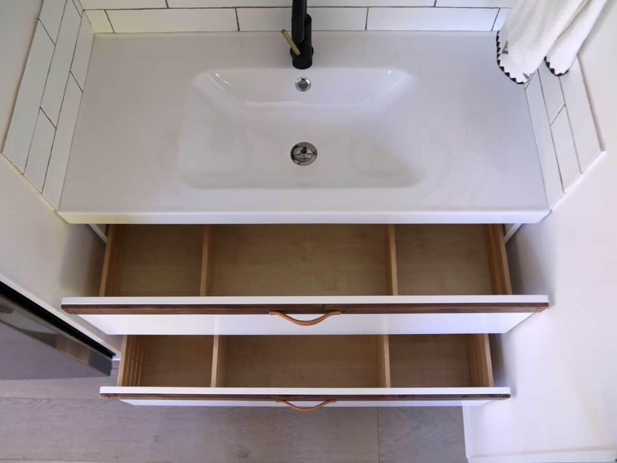 Looking down into open bathroom drawers