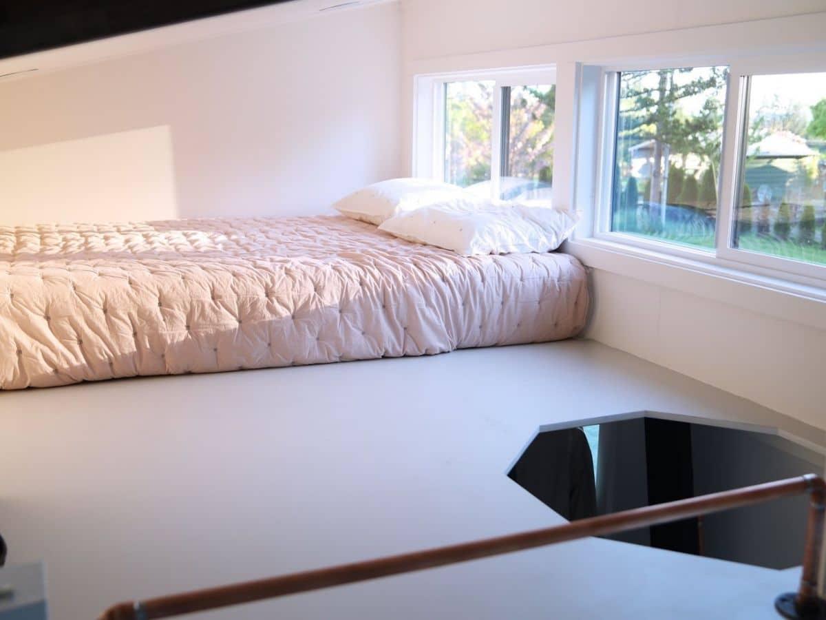 White bed in loft