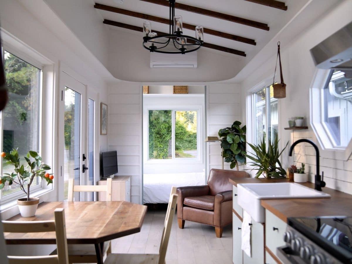 Door open at end of living space where main floor bedroom is