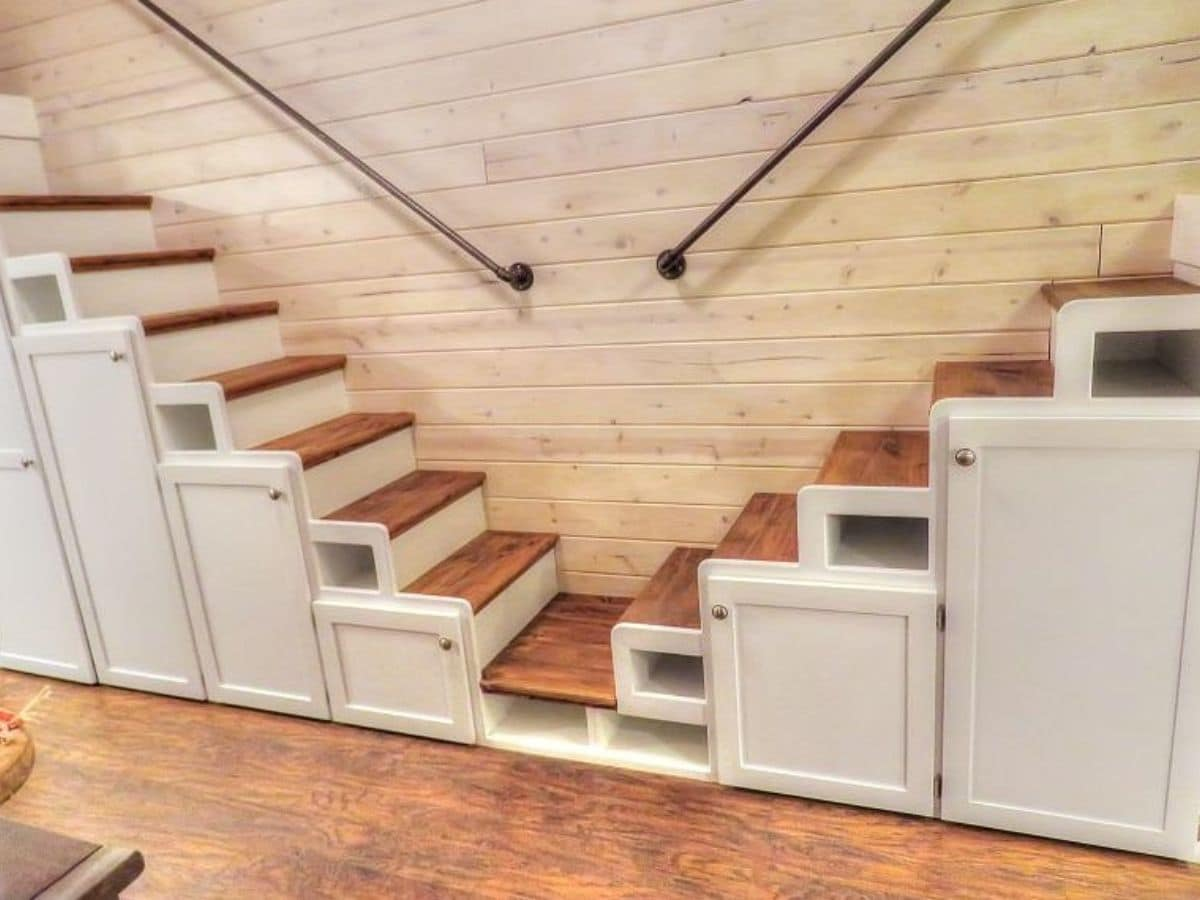 Stairs to loft meeting in middle with cabinets under stairs
