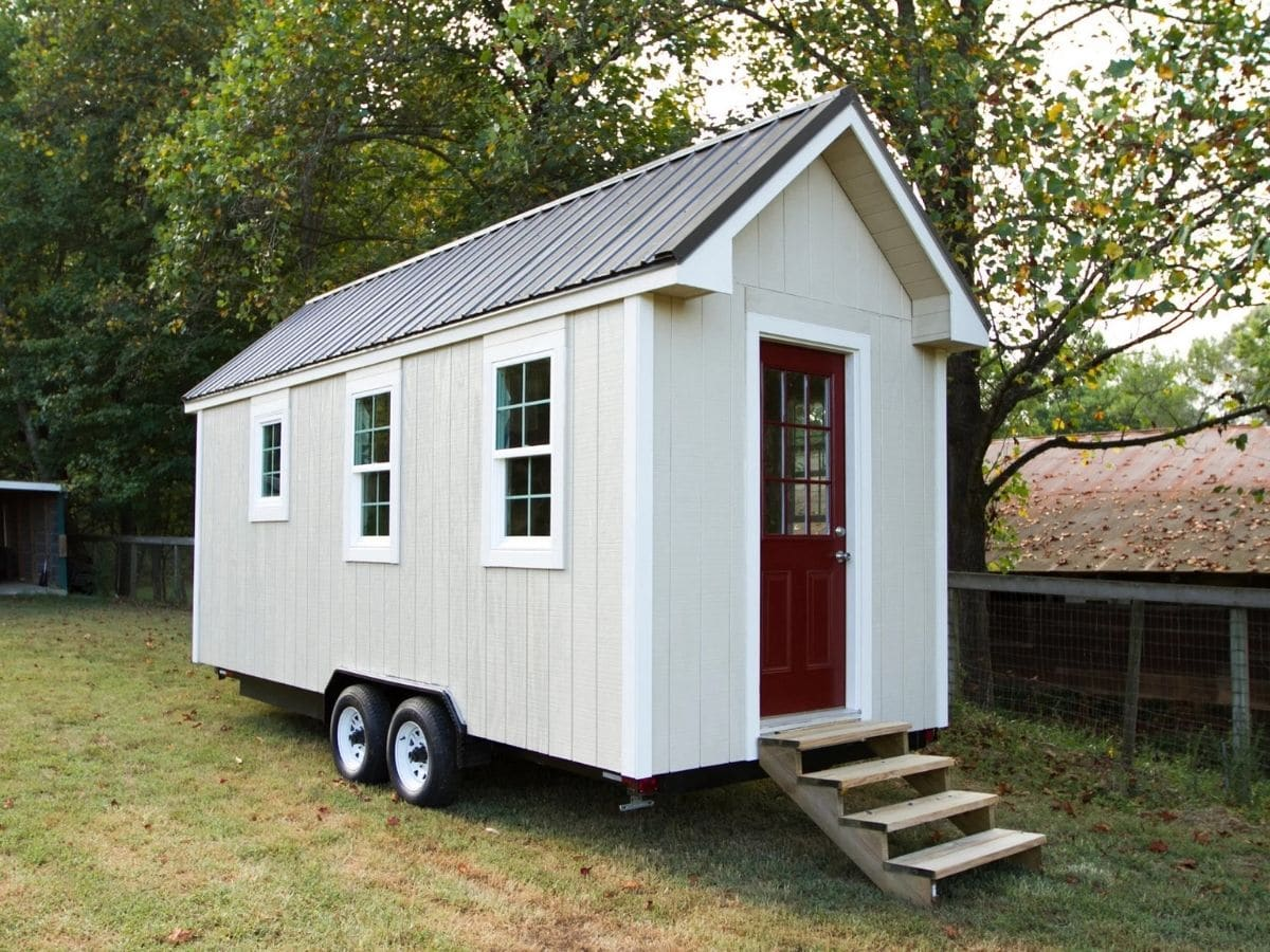 Side of white tiny home with three windows