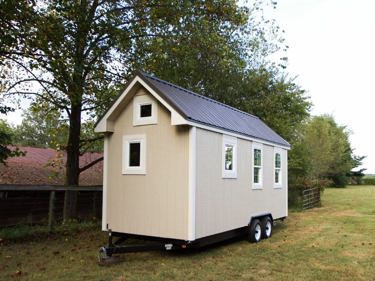 Back of tiny house with two small windows