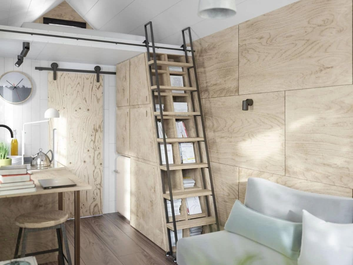 Wood ladder in front of storage leading to loft