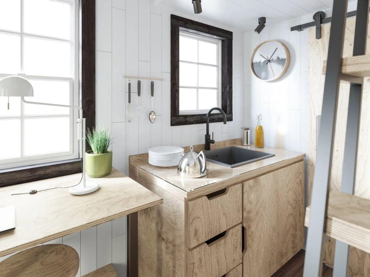 Wood cabinet with drawers around deep sink under window