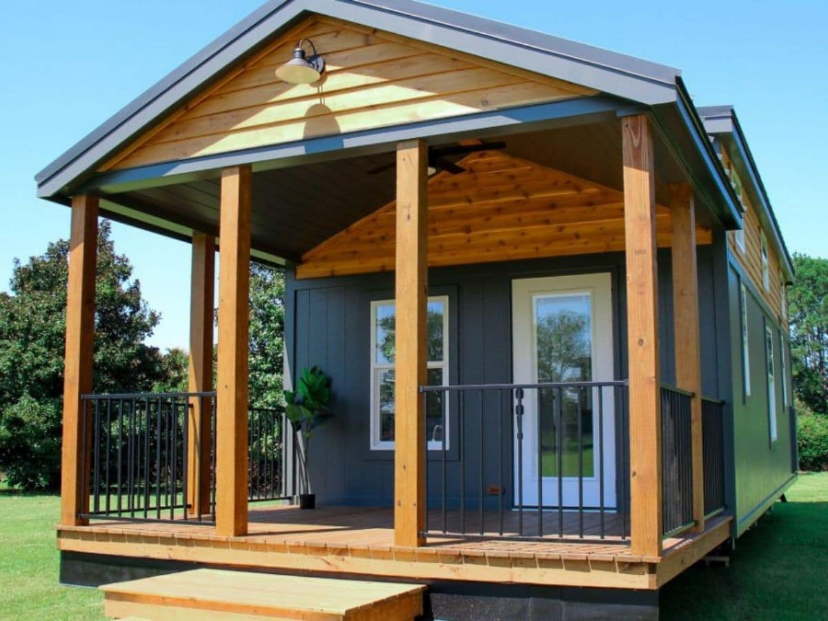 Wood front porch on blue tiny home