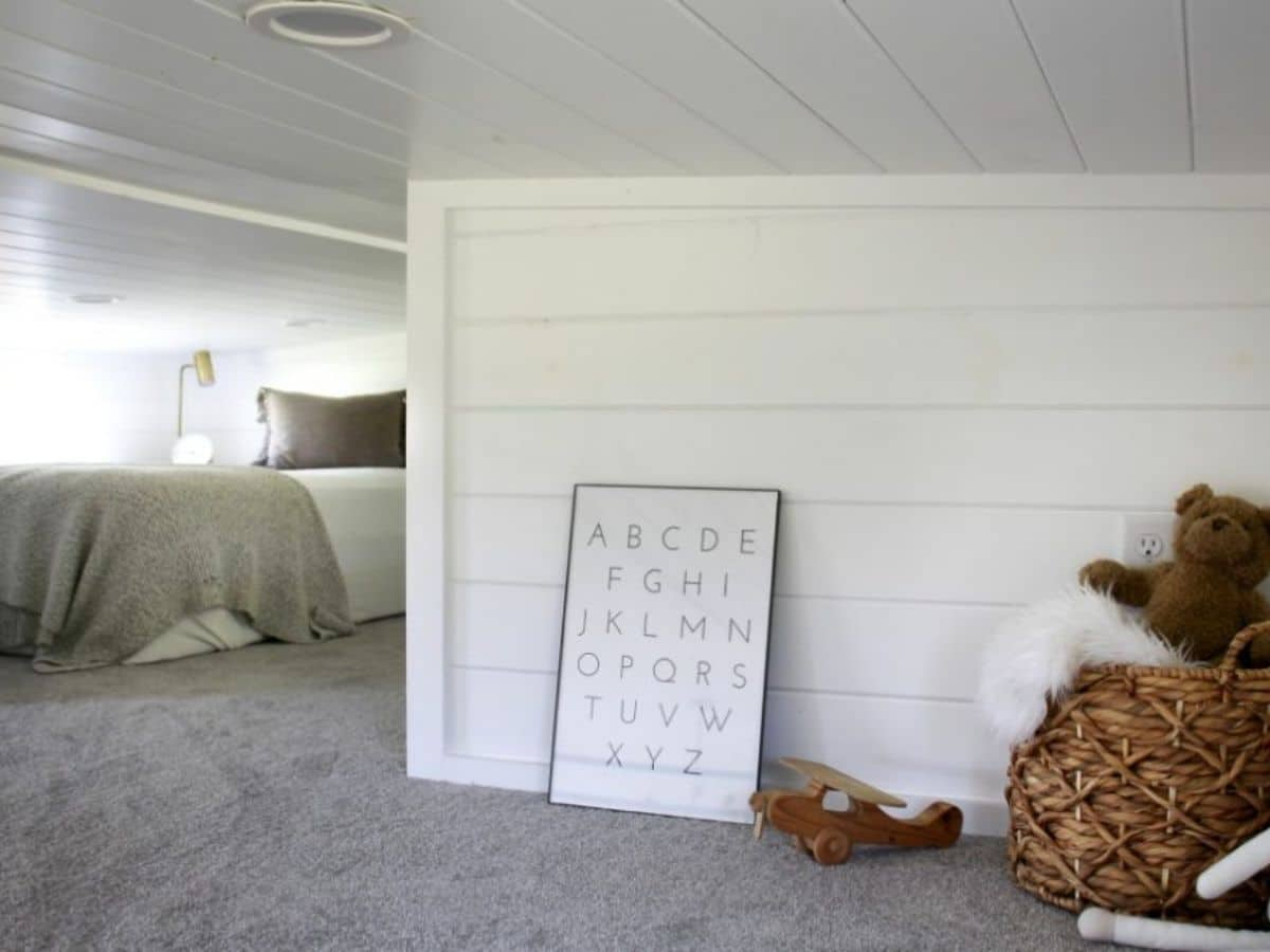 Wall in loft with picture leaned against wall and be in background