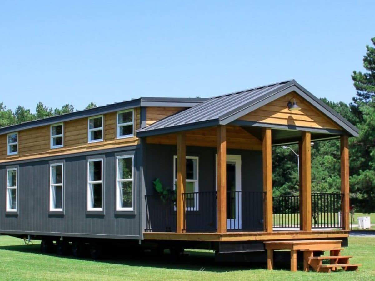 Wood and dark gray tiny home with front porch
