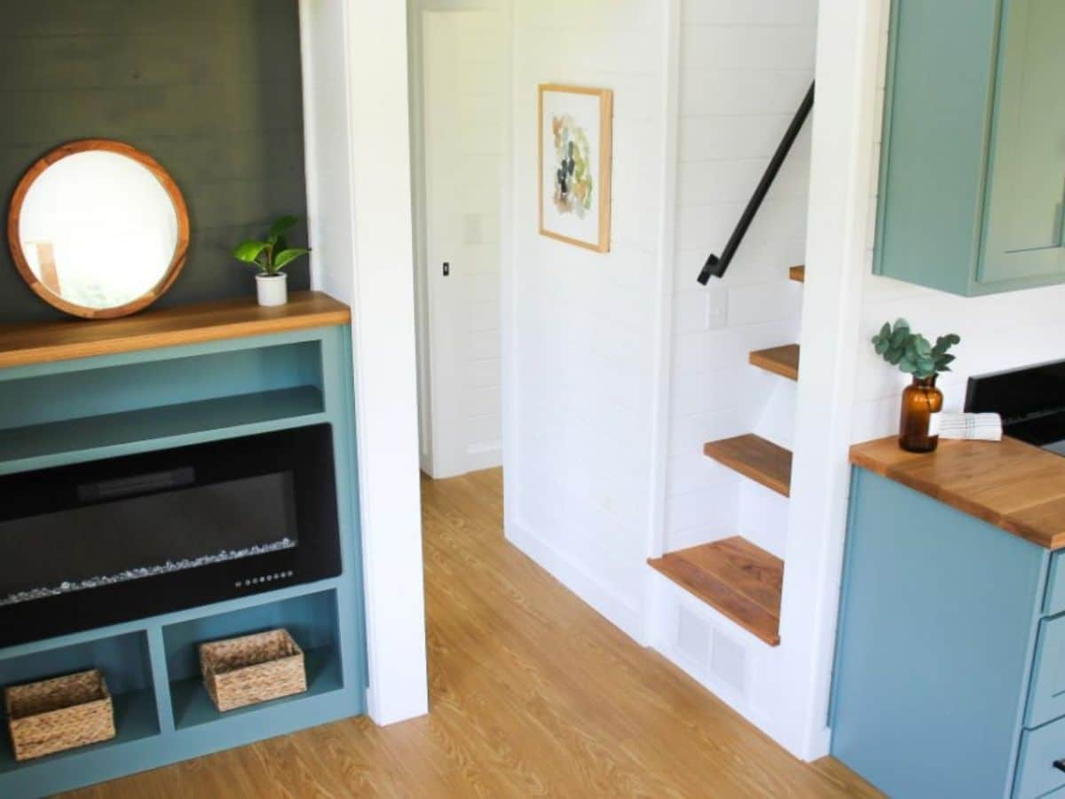 Fireplace in wall inset across from stairs to loft