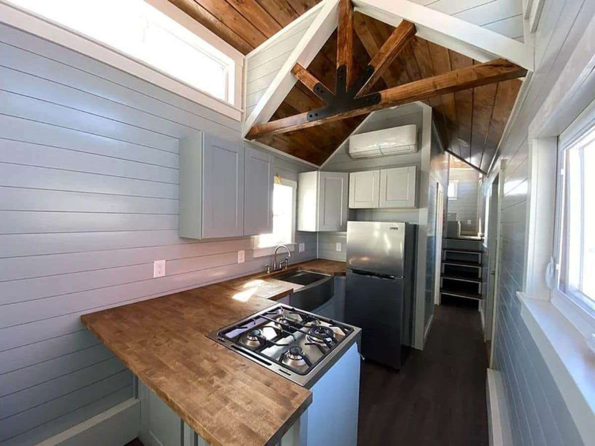 Kitchen in tiny house on wheels with wood counter