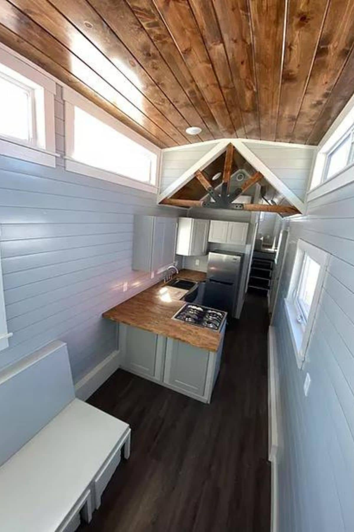 White shiplap walls and wood ceiling inside tiny home on wheels