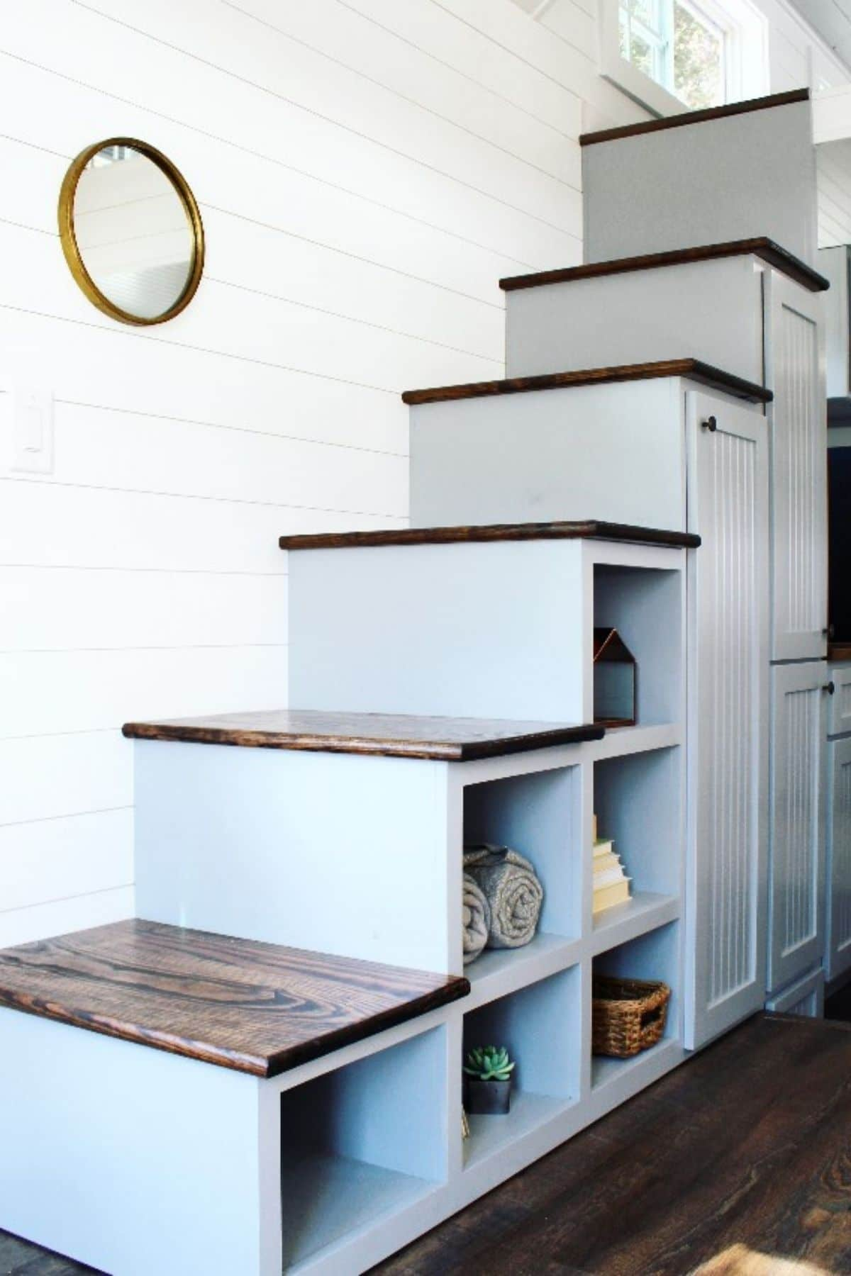 Gray steps to loft with wood tops and open cubbies