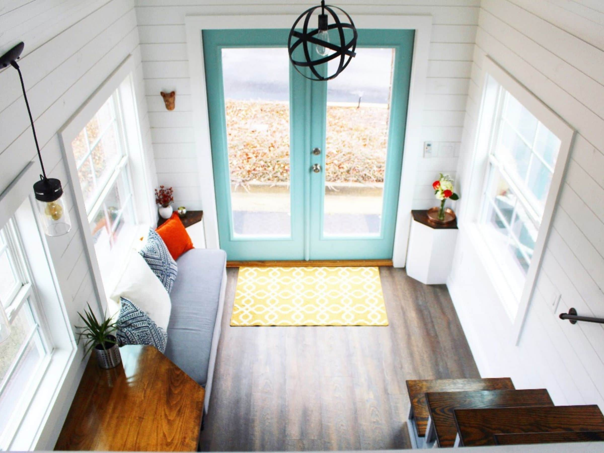 View from loft of tiny home living space