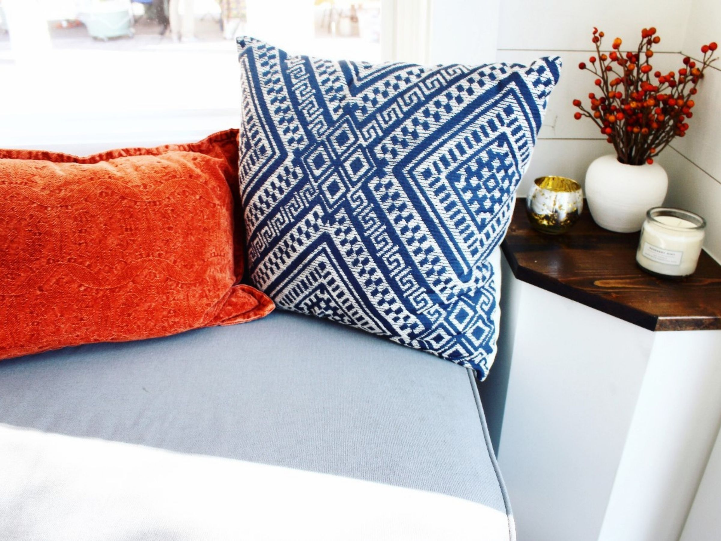 Pillows on bench seat inside tiny home front door