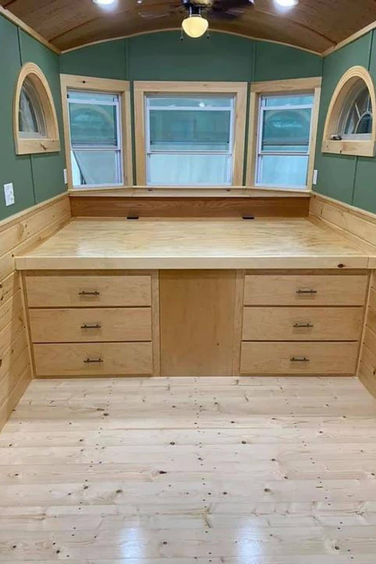 Captains bed with top down showing space against wall with drawers on both sides