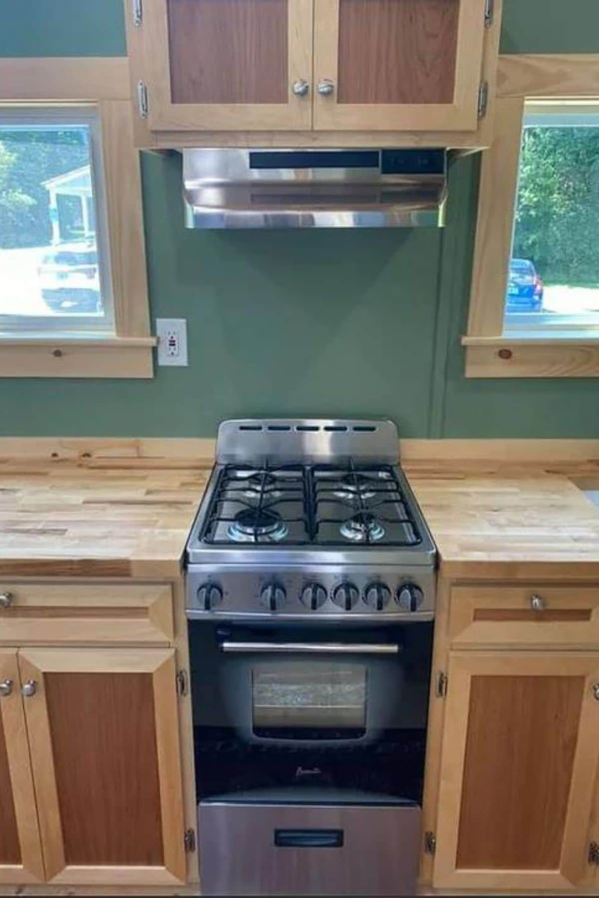 4 burner gas stainless steel stove in butcher block cabinets