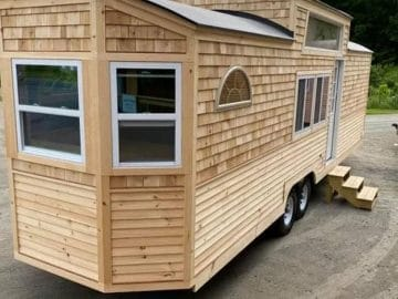 Front of tiny home on wheels with wood slat siding