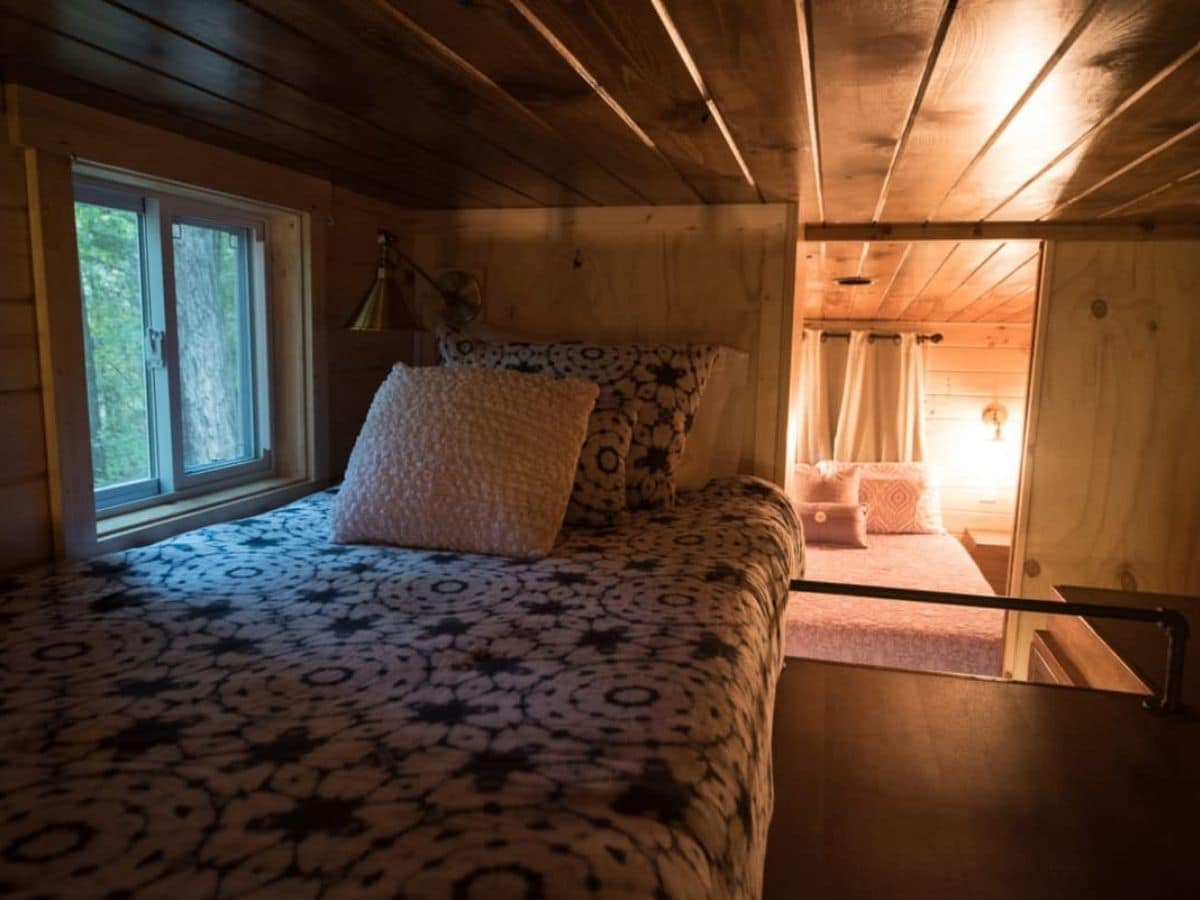 Twin bed against wall in loft