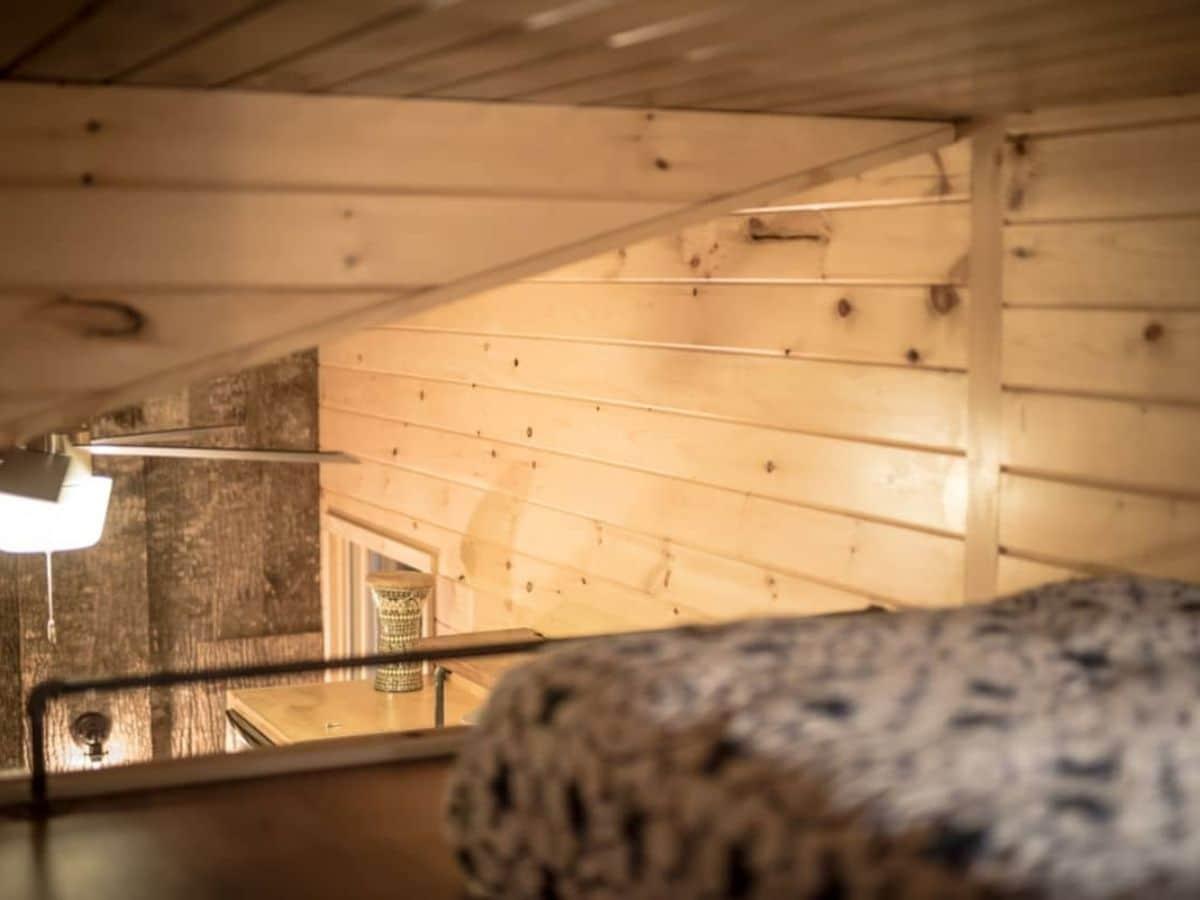 Open end of loft bedroom looking down into main floor of home