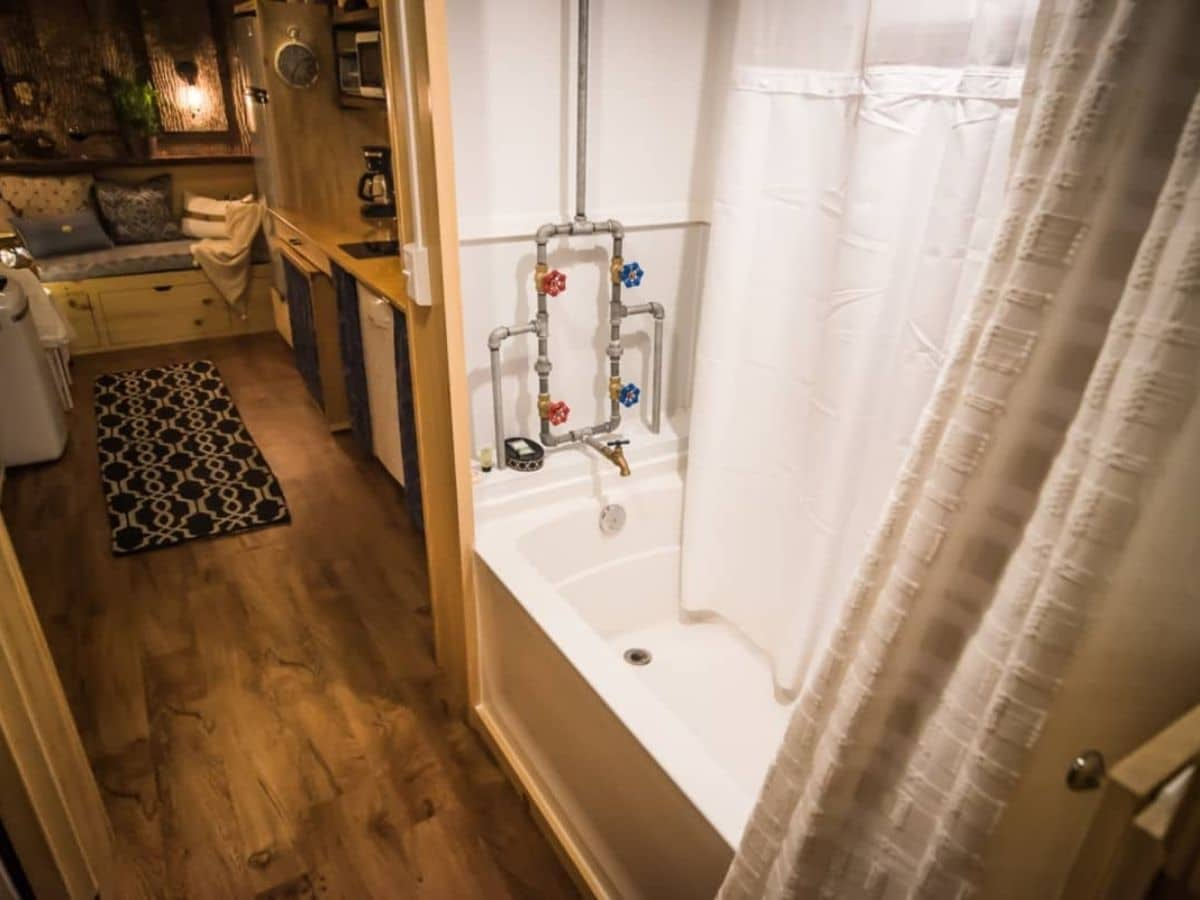 Shower and bathtub combination with open pipes