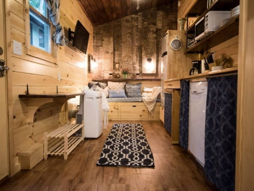 Black and white rug in middle of tiny home living space