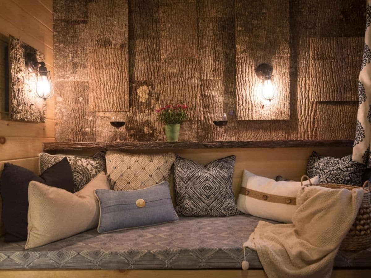 Sofa bench against reclaimed wood wall in tiny home