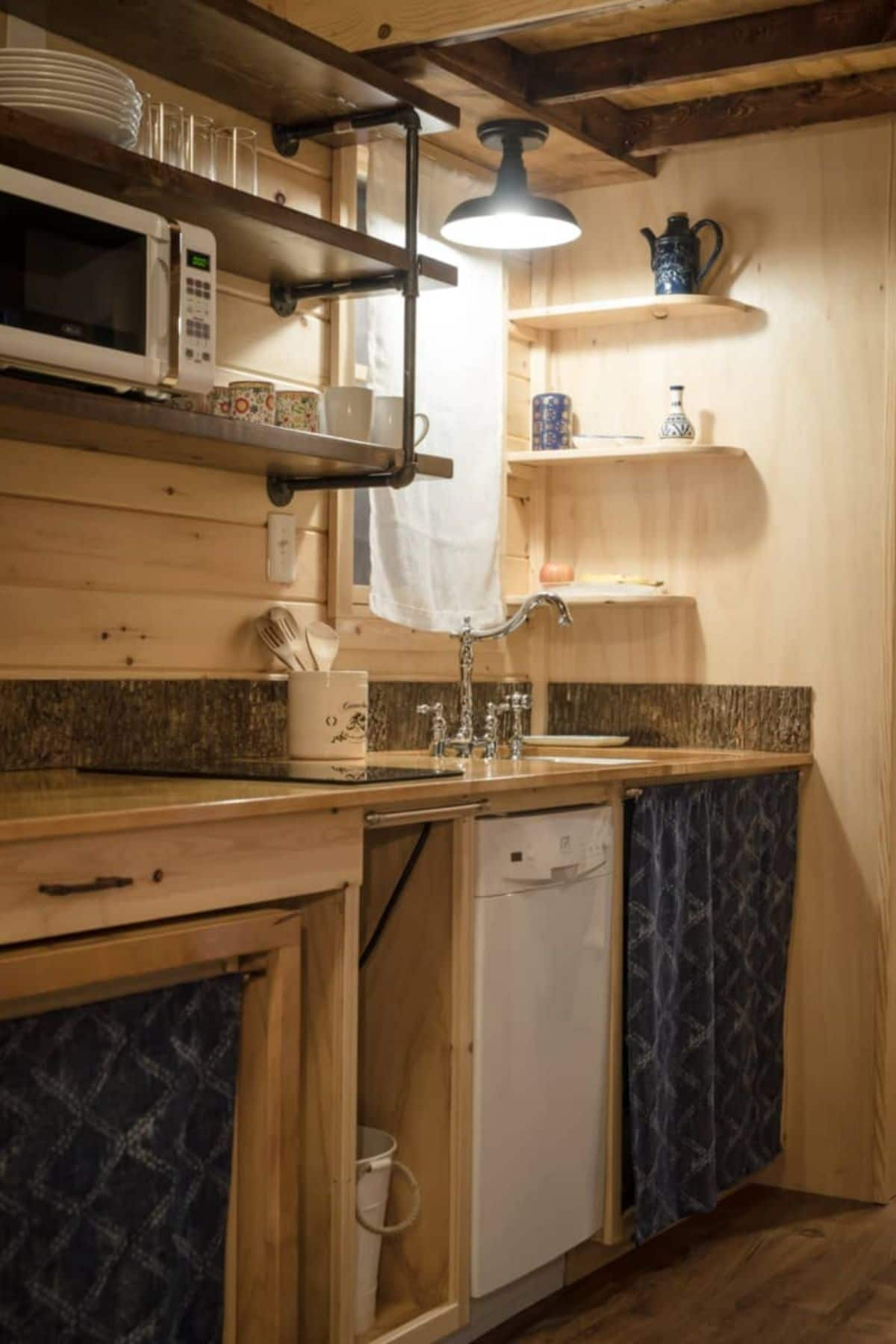 Kitchen with butcher block countertops with open shelving along light wood walls
