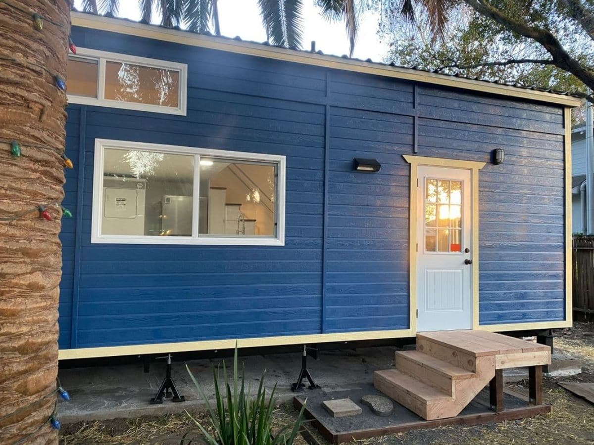 blue tiny house with white front door