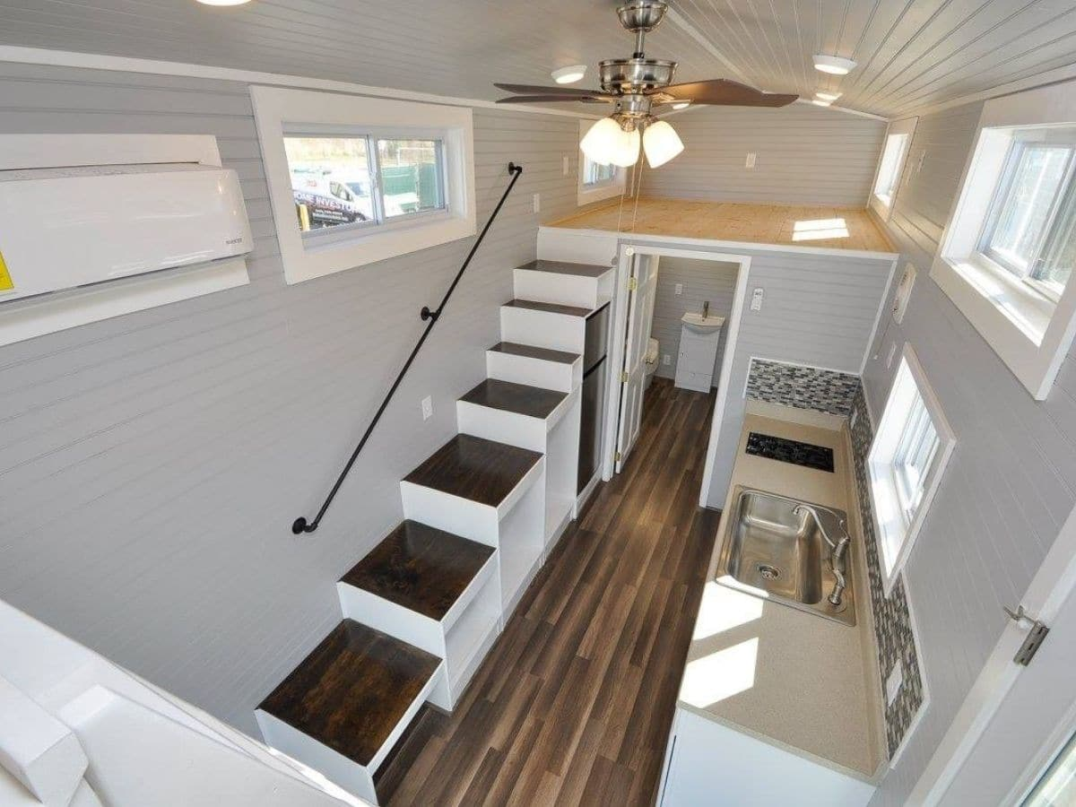 View down from loft into tiny home kitchen