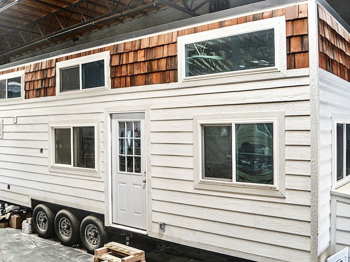 White siding with cedar slat trim on tiny home