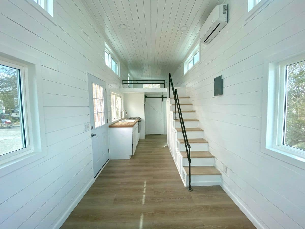 White walls and light wood floor in tiny home