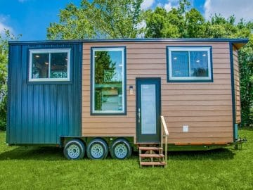 Tiny home with wood and teal siding and white trim