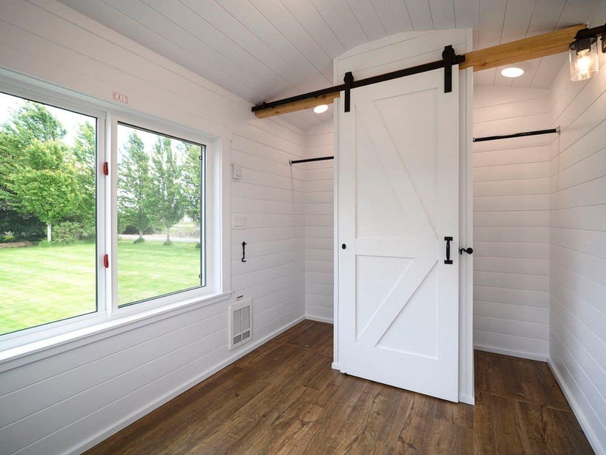 Barn door style closet door open in bedroom
