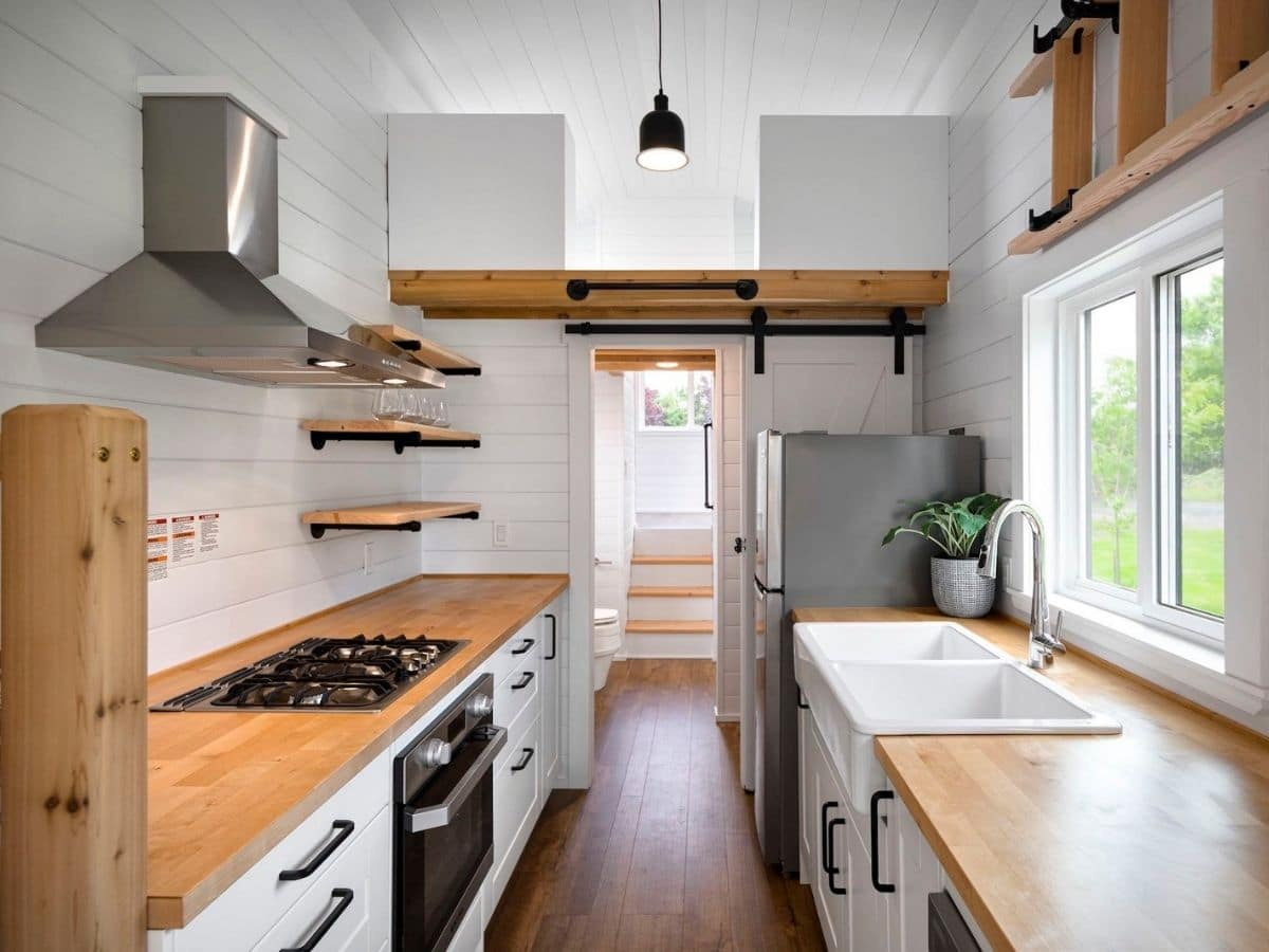 View down middle of tiny home kitchen