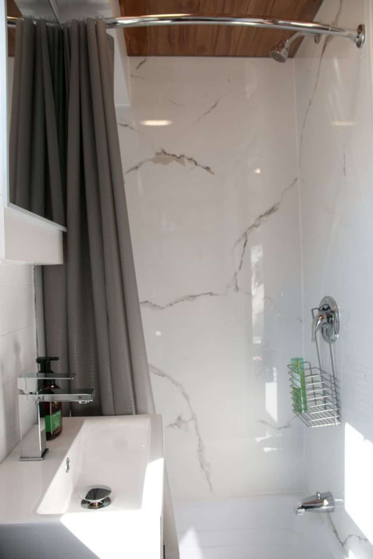marble shower stall with white sink