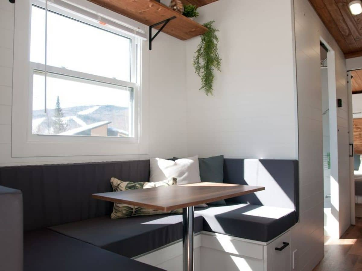 gray dining both with table in center