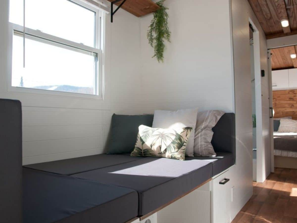 dining table folded down into gray single bunk above white drawers