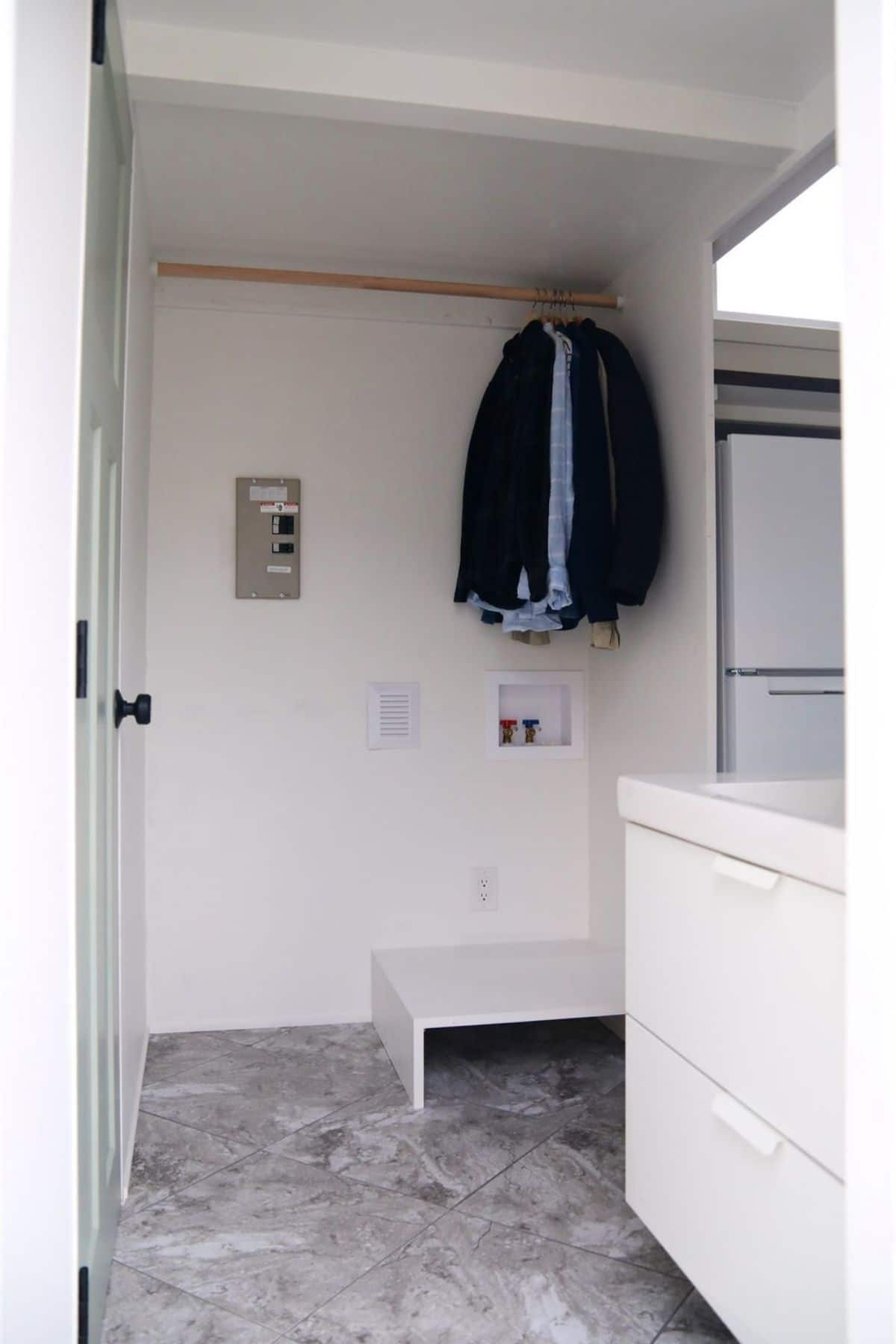 Closet with clothes on rod