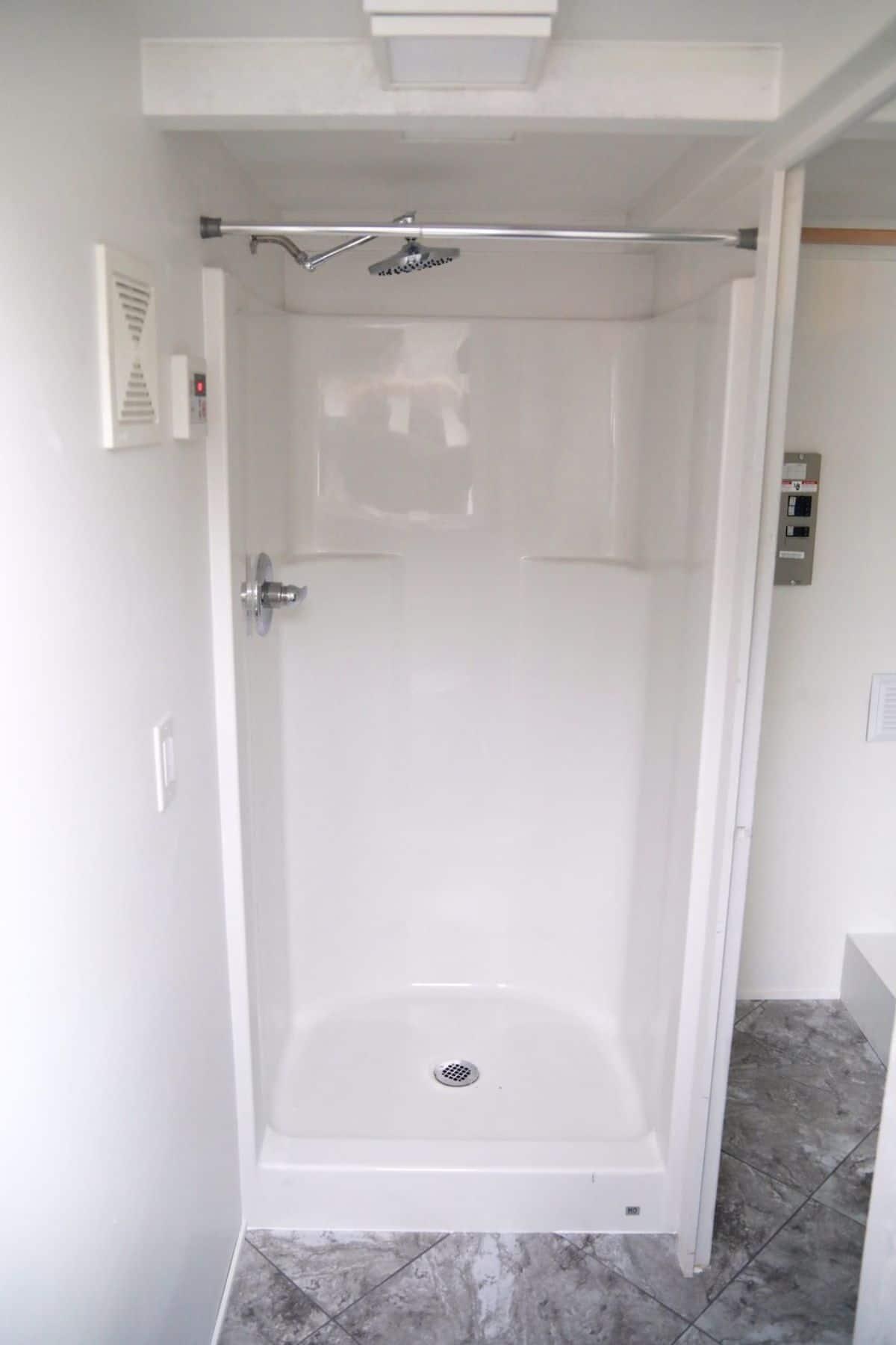 White shower insert with rainwater showerhead