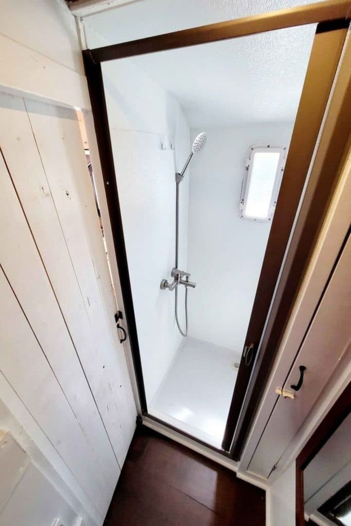 Small shower stall with white walls