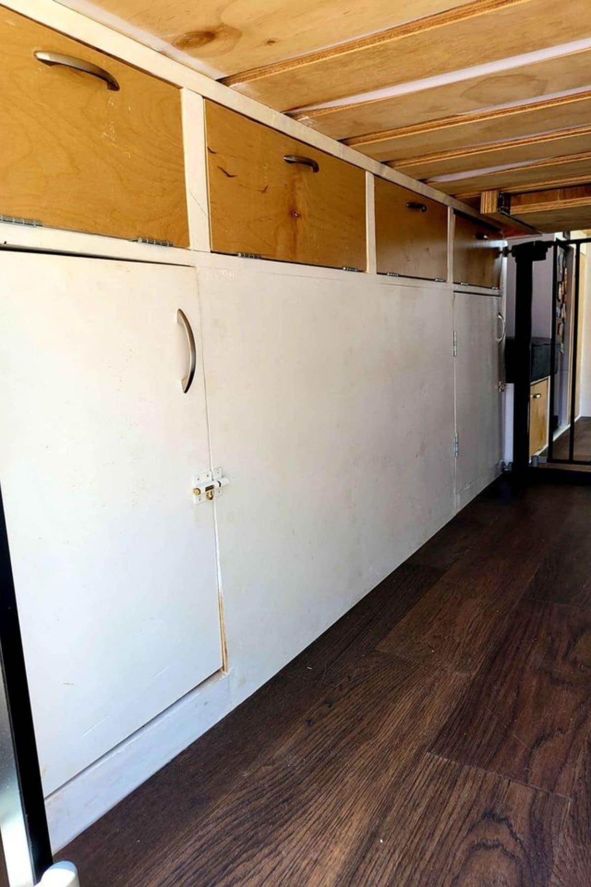 Doors to storage underneath elevated bed