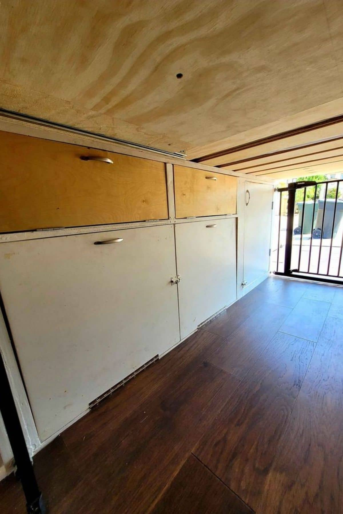 Cabinets beneath elevated bed