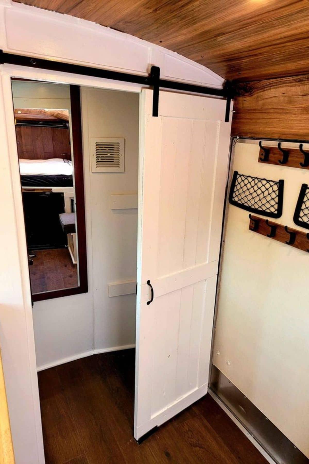 Barn door closure open to bathroom