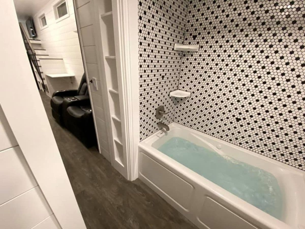 black and white tile in shower and bathtub