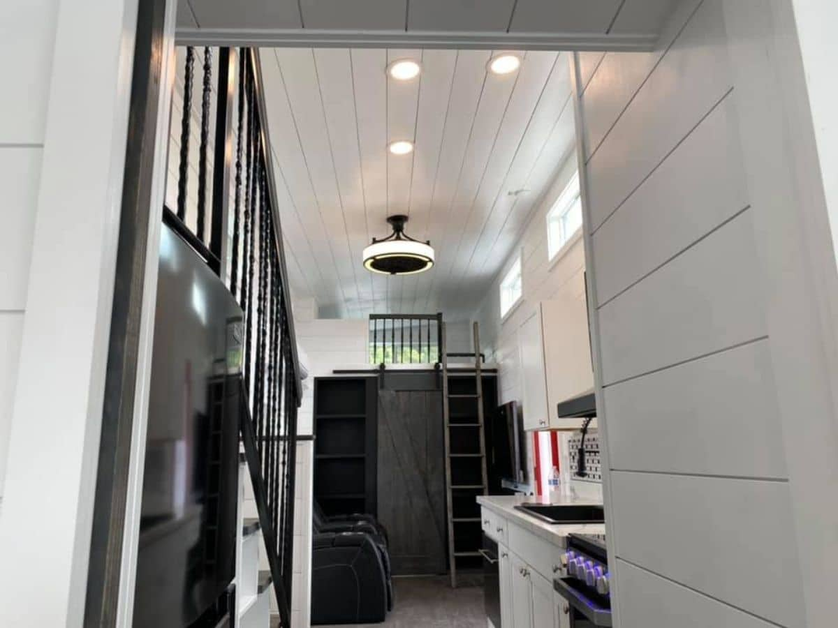 View from bathroom door into tiny home living room