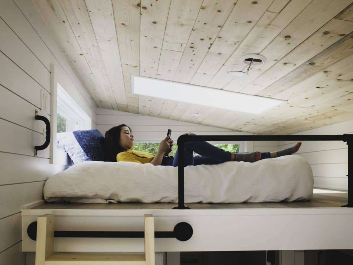 Girl laying on bed in loft