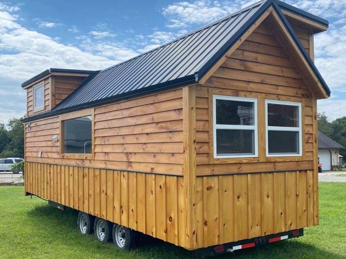 Back side of log cabin tiny house