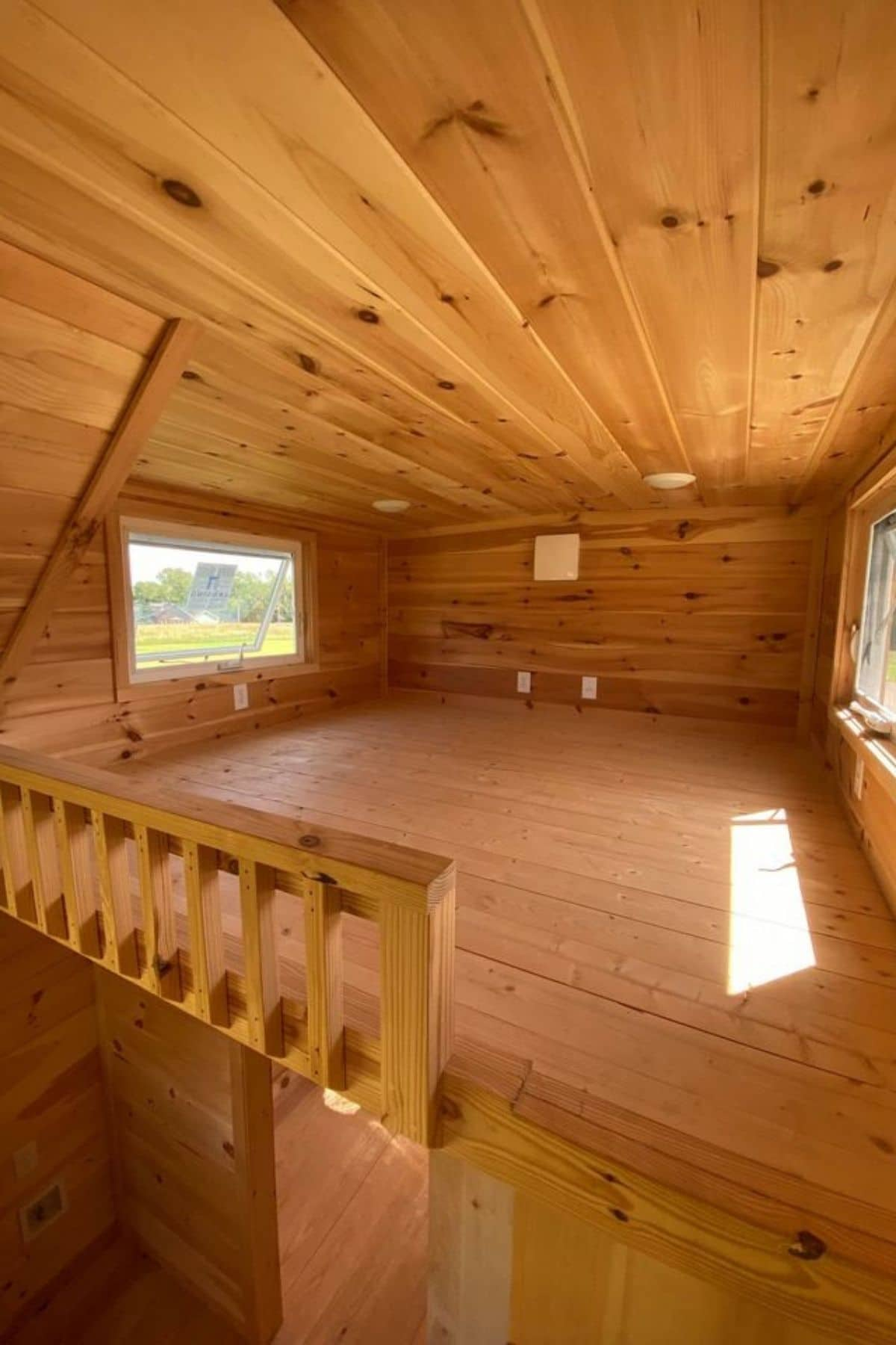 Open wooden loft with windows on both sides